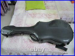 One high quality carbon fibre guitar case 41 With a combination lock